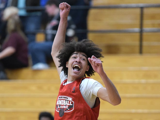 Rochester's Devon Hemer reacts to a teammate's dunk during the 1A, 4A Roundball Classic Thursday at Geneva College. Hemer was the 1A MVP with 23 points.