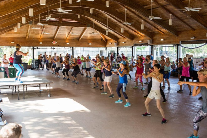 Residents take part in one of the many group exercise classes at the 2019 National Senior Health & Fitness Day event at the pavilion.