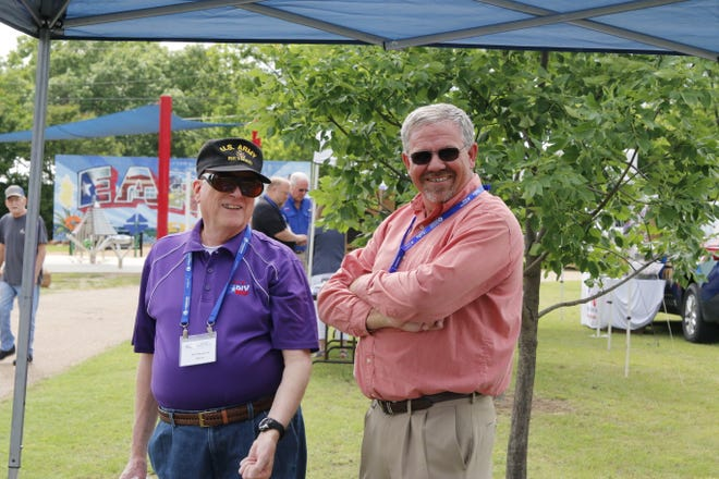 Early Mayor Bob Mangrum (left) and Assistant City Administrator Larry McConn are pictured at the Smart City Expo Thursday afternoon at  McDonald Park. The public was invited to come meet representatives of the city's departments and see a wide array of tools, technology and equipment.