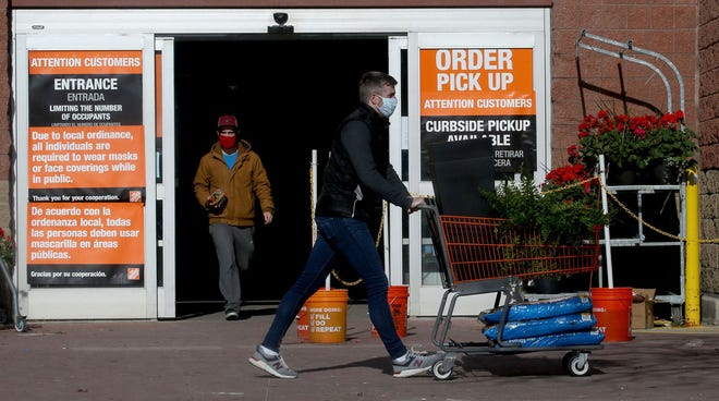 Home Depot said they don't immediately plan to change their policies advising face coverings be worn inside their stores. (Antonio Perez/Chicago Tribune/TNS)