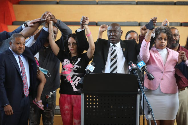 Attorney Ben Crump, center, stands with members of Andre' Hill's family, including daughter Karissa Hill, center left, and sister Shawna Barnett, right, during a press conference on Friday at the Idea Foundry. The City of Columbus will pay the Hill family $10 million after Hill was shot and killed by Columbus Police officer Adam Coy in December. Coy is charged with murder in Hill's death.