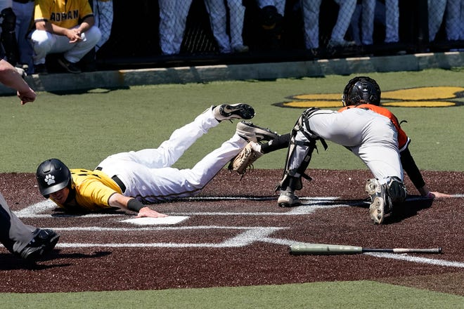 Adrian College's Sean O'Keefe slides into home before the tag during Friday's game against Kalamazoo College.