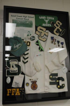 Bob Hinsdale's collection display at Sand Creek's gym.