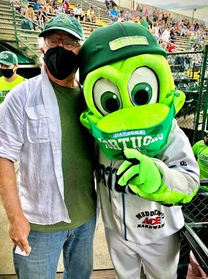 Columnist Mark Lane, left, with Daytona Tortugas mascot Shelldon, both safely masked at the Daytona Tortugas' first home opener since the pandemic began.