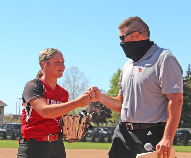 Coldwater senior Mia Rzepka (left) was formally announced as a finalist for the Michigan High School Coaches Association Rich Tompkins Multi Sport Award by Coldwater Athletic Director Todd Farmer Thursday at the Cardinals softball double header with Quincy.