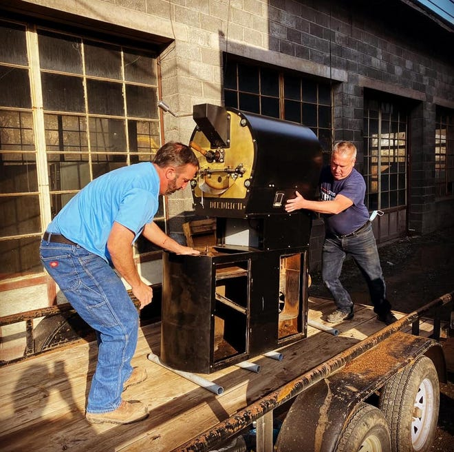 The roaster is moved out of the Black and Brass Coffee Roasting Co.'s original cafe, at 520 Main St., Honesdale. / Black & Brass photo