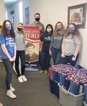 From left, McKenzie Shatzer, Allie Morgan, Ryland Zimmerman, Grace Shatzer, Peyton Barvinchack and Emma Bathgate are among the members of the Blue Devil Scholars, the Greencastle-Antrim High School chapter of Rho Kappa, the national social studies honor society, working the Hometown Hero banners project.