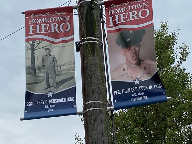 The banners around Center Square in Greencastle honor Hometown Heroes who were killed in action, including Harry R. Pensinger in World War II and Thomas R. Cook Jr. in Vietnam.