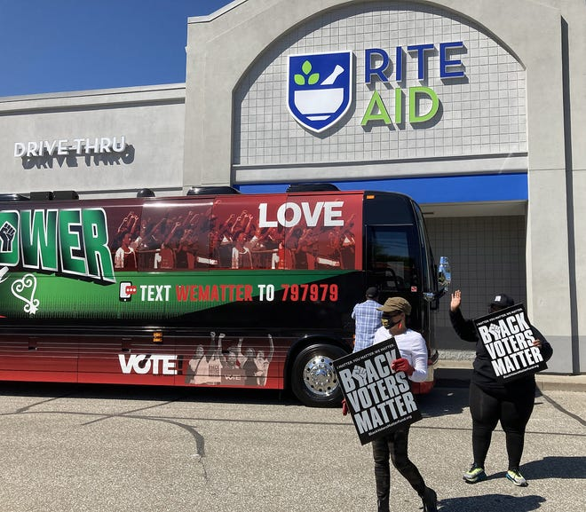"""Members of the organization """"Black Voters Matter"""" arrive at Ride Aid, at 353 E. Sixth St. in Erie, on May 14, 2021 in Pennsylvania. The visit was part of the organization's Pennsylvania """"Get Out The Vote"""" bus tour."""