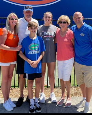 Oakmont Athletic Hall of Famer Kelley (Halloran) Pavinelli, left, spends the majority of her free time these days following the athletic exploits of her four kids, including son Joey (third from left) and daughter Danielle, center, who plays lacrosse at the University of Florida. Also pictured are Pavinelli's parents Mike and Sharon Halloran and her husband Rob (far right).