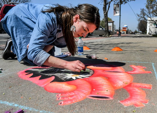 Rebecca Hunt works on her chalk drawing of a heart April 24 at Stevens Park during the Garden City Arts sidewalk chalk contest. The event, which drew 62 participants, was the first community event for the oganization in 2021.