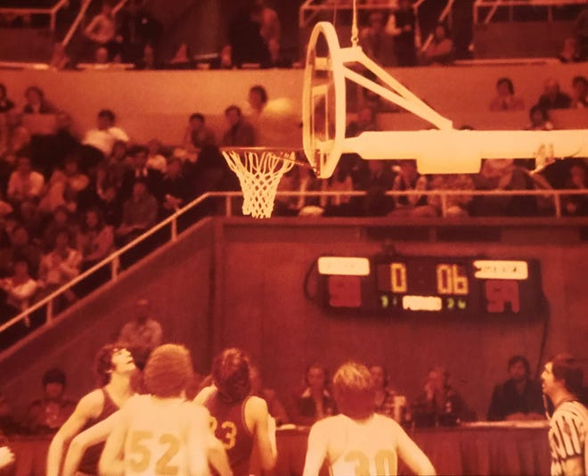 After playing 30 games and all but the final seconds of a 31st, this is what it came down to for ROVA's attempt to win the 1976 Illinois Class A state championship. With Mt. Pulaski leading 59-58, Dwight Peterson's jump shot was just off the mark, and the rebound would elude All-State center Dave Johnson (52).
