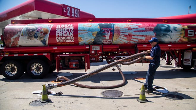 A fuel tanker driver delivers a 9000 gallon load of fuel at the Sheetz in Raleigh Thursday, May 13, 2021. Operators of the Colonial Pipeline say they began the process of moving fuel through the pipeline again on Wednesday, six days after it was shut down because of a cyberattack. (Travis Long/The News & Observer via AP)