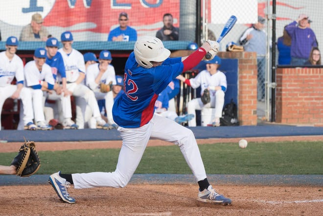 West Henderson's Jordan Whitaker takes a swing during a game last season. Whitaker was the starting pitcher in Thursday's win over T.C. Roberson.