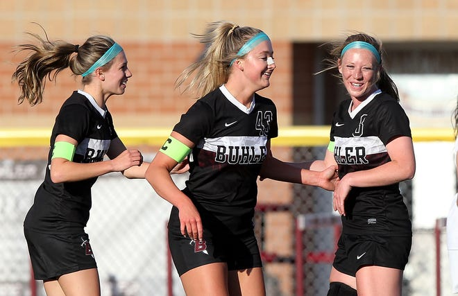 Buhler's Alexis Hutton (43) center, is congratulated by teammates Amaleigh Mattison (2) and Paige McDowell (3) after Hutton scored a goal during their game against Nickerson Thursday night. Buhler defeated Nickerson 10-1.