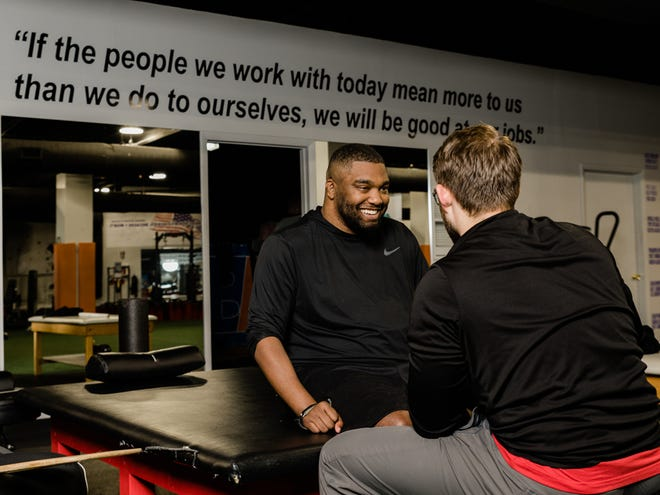 Former Massillon Tiger Rob Partridge is all smiles during a rehab workout in 2020.