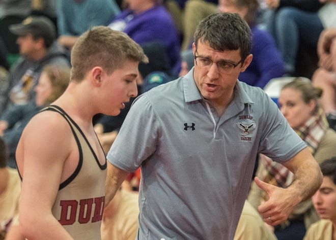Dunlap wrestling coach Rick Mathern, right, counsels wrestler Andrew Schmitt after a 132-pound match during the Bob and Liz Schnarr Invitational on Saturday, Jan. 4, 2020 at Morton Community High School.