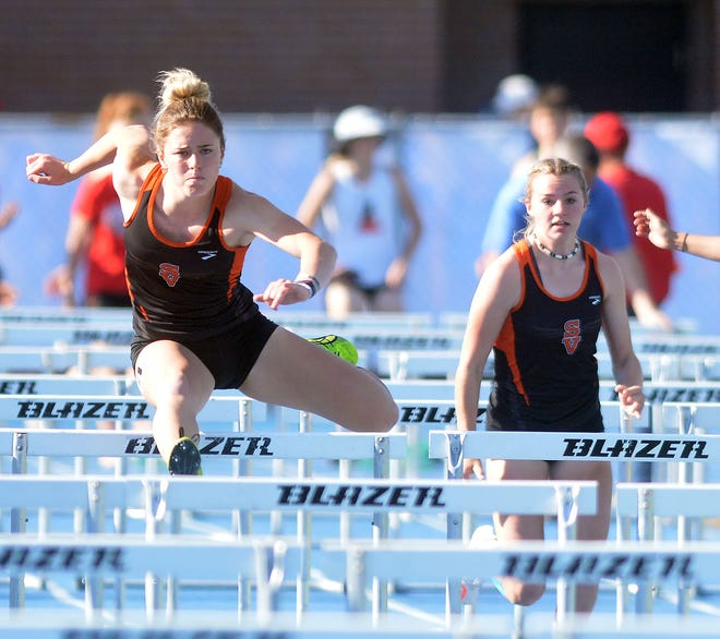 Belle Peters of Smoky Valley, left, holds off teammate Clara McElroy in the finals 100-meter high hurdles during the Cenral Kansas League championships. Peters won four events with two meet records. The Vikings won the meet for the third straight time.