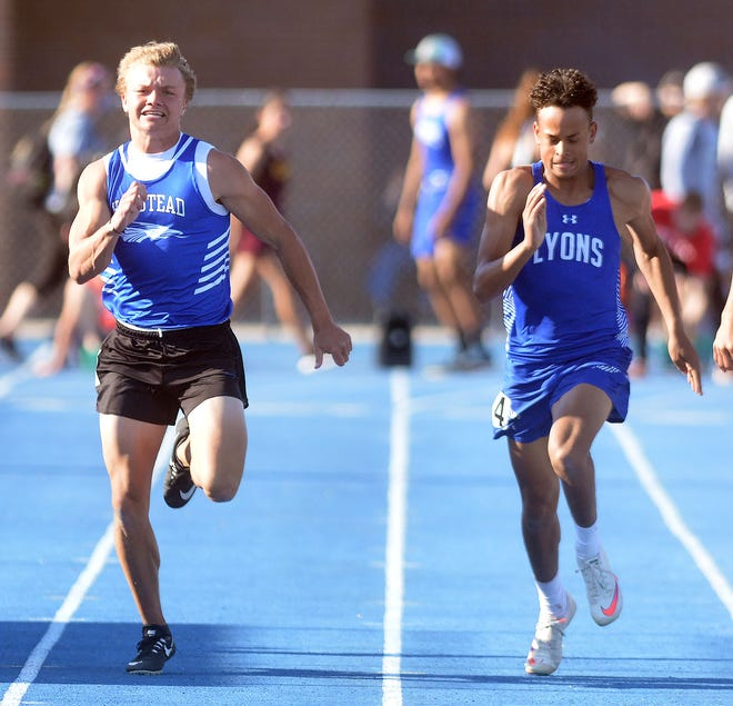 Lakin Farmer of Halstead, left, holds off Carl Clark of Lyons Thursday in the finals of the 100-meter dash at the Central Kansas League Championships. Farmer won the race by .01 seconds.
