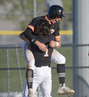 Kirksville's Logan Blickhan jumped into the arms of Patrick Ranson after hitting a walk-off single to beat Moberly on Thursday night.