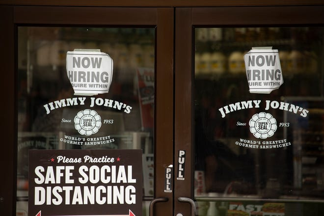 Help wanted sign at the Jimmy John's restaurant in downtown Lakeland Fl. Thursday May 13 2021. Labor shortages affect Lakeland hospitality businesses, restaurantsERNST PETERS/ THE LEDGER