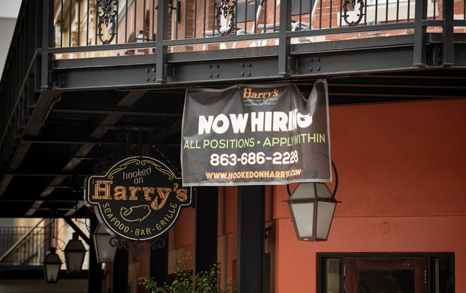 Help wanted sign at the Harry's restaurant in downtown Lakeland Fl. Thursday May 13 2021. Labor shortages affect Lakeland hospitality businesses, restaurantsERNST PETERS/ THE LEDGER
