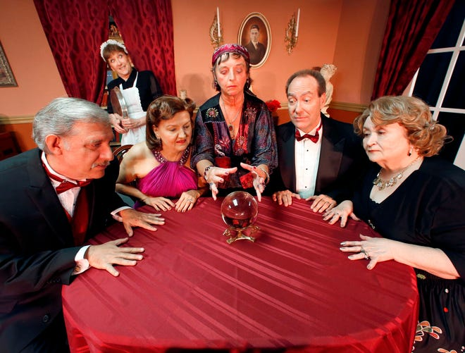 """From left, Wayne Shaw as Dr. George Bradman, Mary Lou Johns/Ganz as Edith, Carol Krause as Ruth Condomine, Donna McOnie as Madame Arcati, Vance Klosterman as Charles Condomine and Renee Palmer as Mrs Violet Bradman in the Haines City Community Theatre production of """"Blithe Spirit"""" in 2017."""