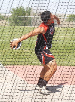 La Junta High School's Zeke Rangel lets the discus fly at the Tiger Relays Friday at Tiger Stadium. Rangel won the event with a personal record of 127 feet, 6 inches.
