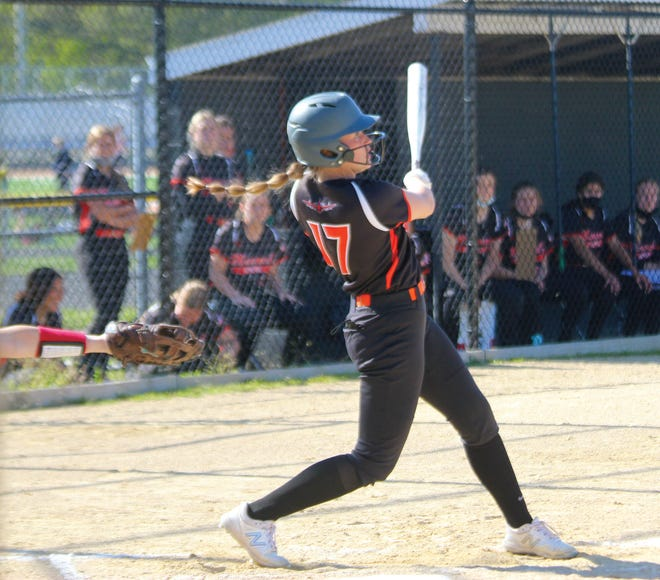 Macomb's Shelby Daniels connects for a hit.