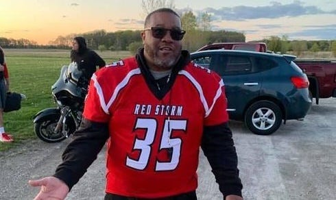 Southeast Michigan Red Storm coach Taylor Bates wears a team jersey at a recent practice. The new semi-pro football team will play its first game today at Navarre Field.