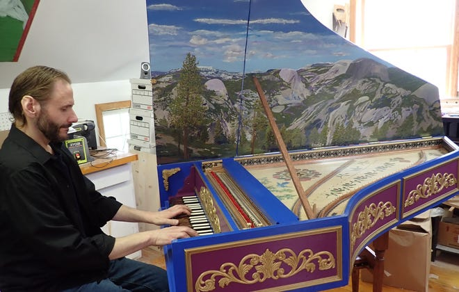 Paul Daher is seen in his home workshop in Green on May 12, 2021, playing the harpsichord he built over the past year. A new harpsichord costs from $10,000 upward.