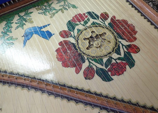 The soundboard and sound-hole of a harpsichord built by Paul Daher is seen in this May 12, 2021 picture taken at his home workshop in Green.