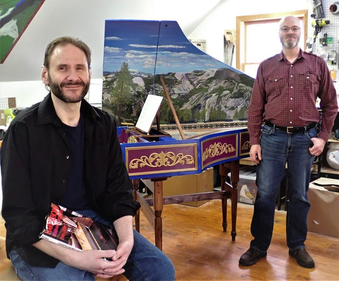 Paul Daher, left, and Jim Hohman pose at their home in Green, with the harpsichord built by Daher as a pandemic project while he was out of work.