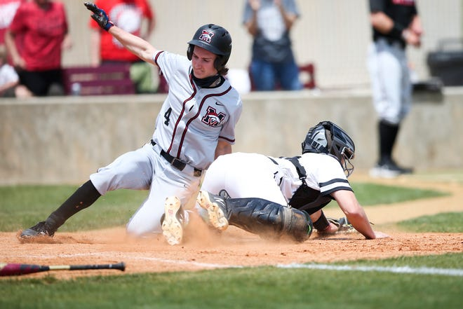 Mustang's Kyle Fenimore slides into home while Union's Brody Briggs fields the ball during the 6A quarterfinal game between Mustang and Union at Edmond Memorial High School on Thursday, May 13, 2021.