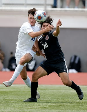 Crooked Oak's Jose Hernandez (28) and Mount St. Mary's Abraham Garcia fight for a ball during the 3A final.