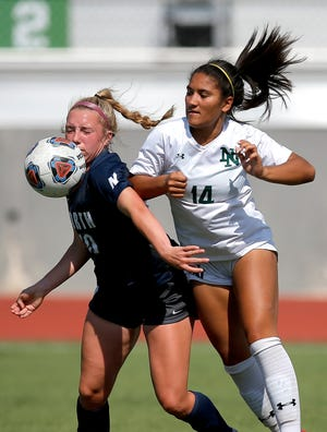 Edmond North's Ava Greene and Norman North's Jada Ryan fight for a ball during the Class 6A state title game on May 14 at Taft Stadium.