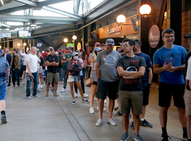 Fans stand in line for concessions Thursday during the minor league baseball game between the Oklahoma City Dodgers and the Sacramento River Cats at the Chickasaw Bricktown Ballpark.
