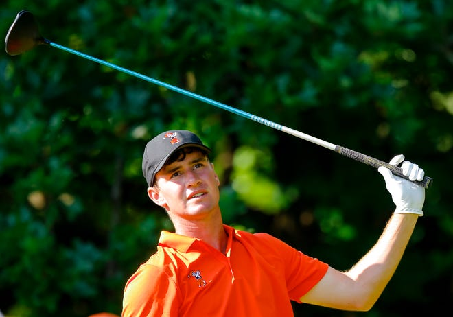 Oklahoma State's Austin Eckroat reacts to his tee shot during the 2018 NCAA championships at Karsten Creek Golf Club in Stillwater on May 29, 2018.