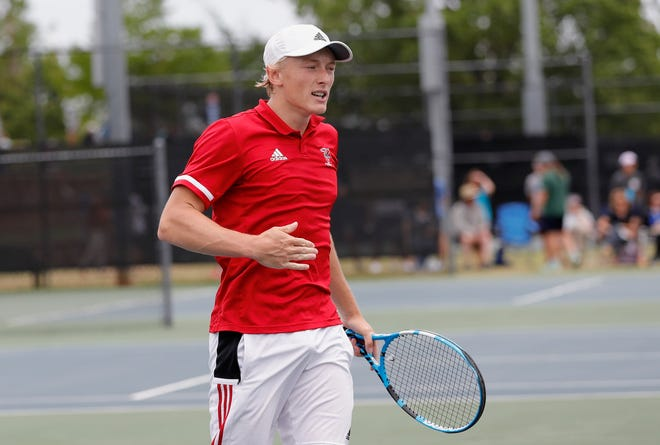 Yukon's Nate Moore reacts after defeating Edmond Memorial's Logan Lemley in the Class 5A No. 1 singles state tournament Friday at the Oklahoma City Tennis Center.