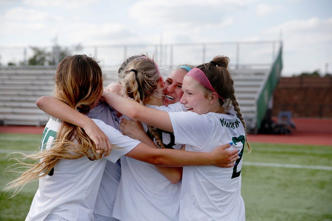 Norman North celebrates after winning the Class 6A girls soccer state title over Edmond North at Taft Stadium on May 14.