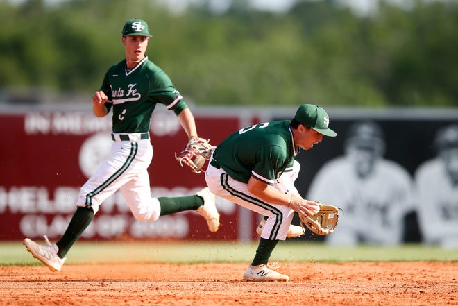 Edmond Santa Fe's Cayden Brumbaugh, fielding a ball during the Class 6A quarterfinals, was one of the players selected to the Oklahoma City Area Baseball Coaches Association All-Star game.