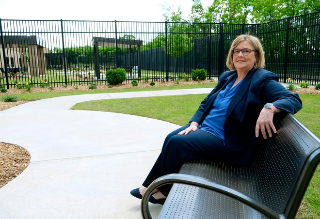 """Jayne Van Bramer, CEO of Oakwood Springs, is seen in a courtyard of the behavioral health hospital in northern Oklahoma City The hospital raised concerns with the city about an upcoming concert set """"next door"""" to the facility that leaders feared would disrupt patients."""