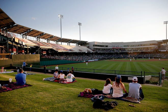 Fans sitting behind the right field fence get a view of the Oklahoma City Dodgers game against the Sacramento River Cats on Thursday night at the Chickasaw Bricktown Ballpark. It was the Dodgers' first game at the ballpark since Sept. 2, 2019.
