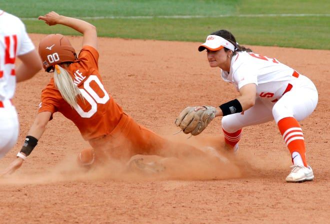 Texas' Lauren Burke is tagged out at second base by Oklahoma State's Kiley Naomi on Friday during the Big 12 softball tournament at the USA Softball Hall of Fame Complex in Oklahoma City, Okla.
