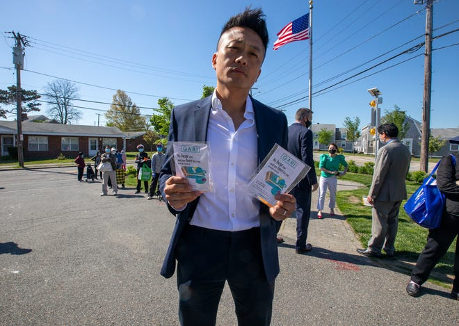 """QARI CEO Phillip Chong holding whistles that are part of his nonprofits """"Whistle Against AAPI Hate"""" project."""