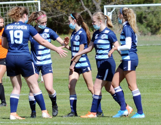Petoskey players had reason to flock to Hayley Flynn (second right right) again Thursday, with the junior notching a pair of scores against the Vikings in a BNC win.