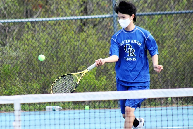 Oyster River High School's Leo Li hits a forehand return during tennis action Thursday against Sanborn at the Woodridge Park courts in Durham.