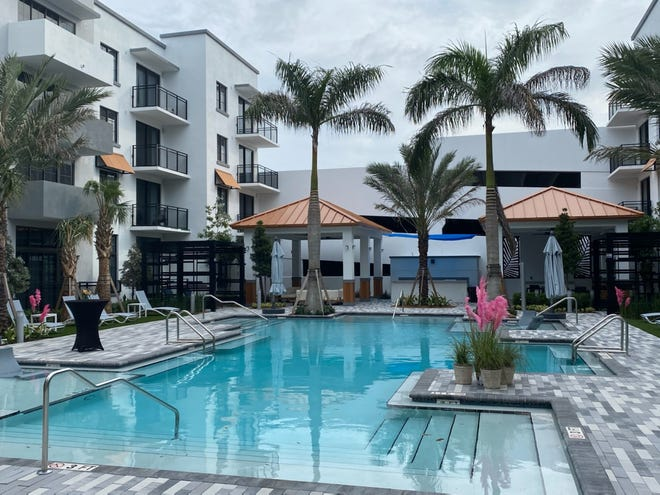 Pool view of the District Flats apartment complex in West Palm Beach's Warehouse District. The 178-unit complex was built in 18 months and is located about a quarter-mile from the Grandview Public Market. WAYNE WASHINGTON/PALM BEACH POST