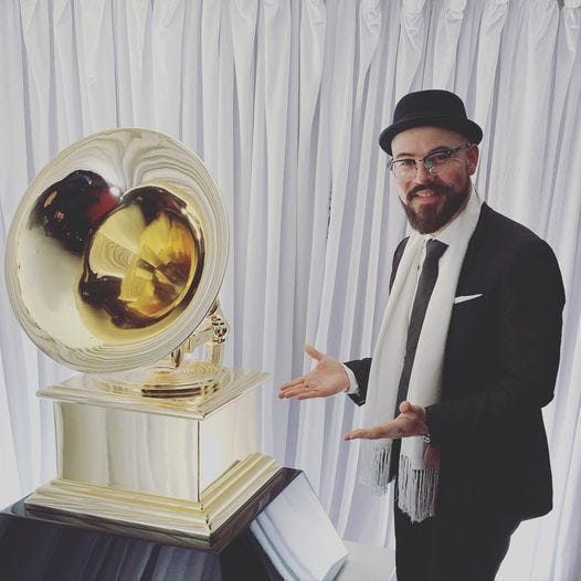 Trumpeter Charlie Porter, a 1996 graduate of the Alexander Dreyfoos School of the Arts in West Palm Beach, poses with the Grammy Award he won in 2020.
