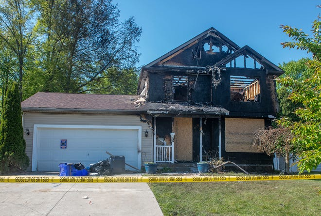 The Portage County Fire Inspection Unit was on scene at the day after a fire devastated this house on Harvest Drive in Ravenna on Thursday.